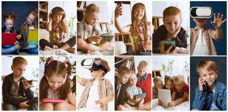 Porträt von Kindern unter Verwendung der verschiedenen Geräte auf Mehrfarbenhintergrund lizenzfreies stockfoto