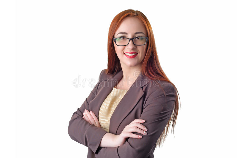 Porträt von schönen tragenden Gläsern der RothaarigeGeschäftsfrau stockbild