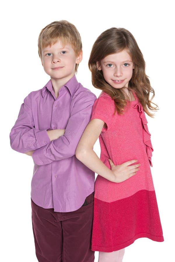 Porträt von zwei Modekindern lizenzfreie stockfotos
