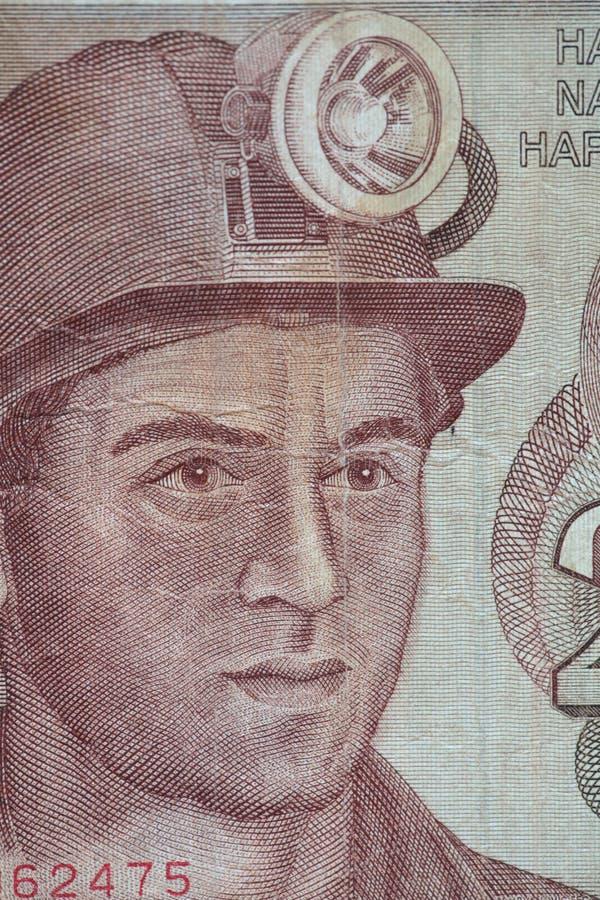 Porträtarbeitskraft auf einer Banknote lizenzfreies stockbild