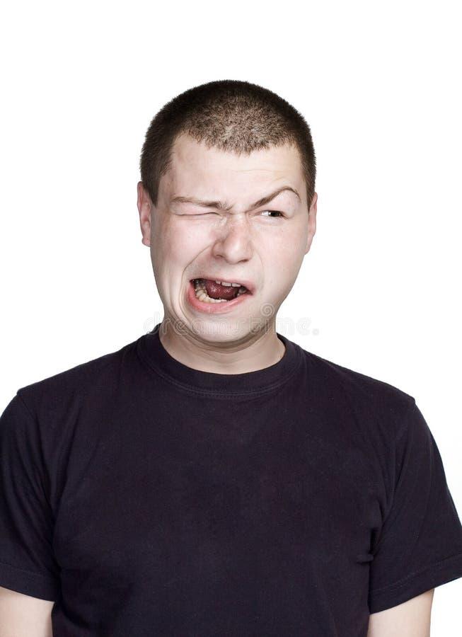 Portr?t des jungen Mannes Lustiges Gesicht Grimassengesicht stockbild