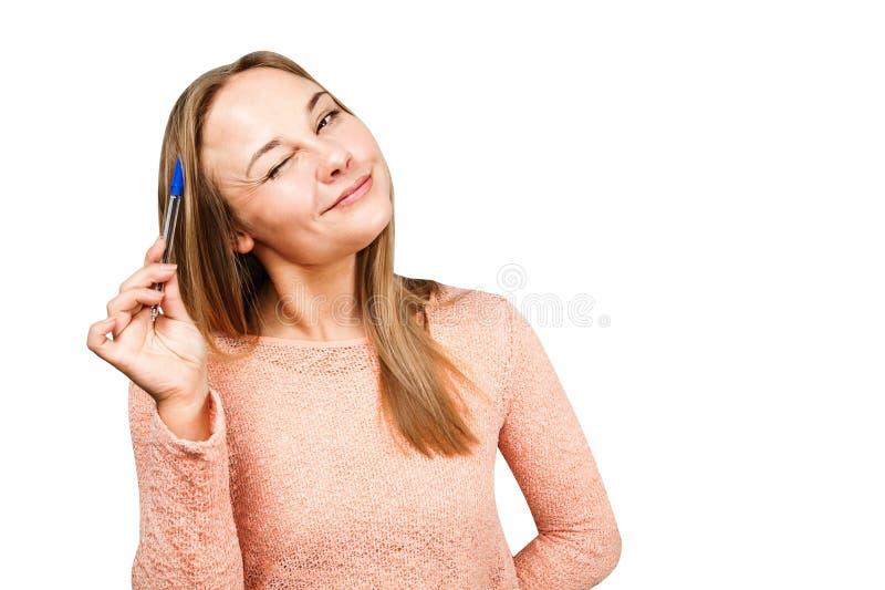 Portr?t eines jungen sch?nen M?dchens, das in ein Notizbuch schreibt Getrennt auf wei?em Hintergrund lizenzfreie stockfotos