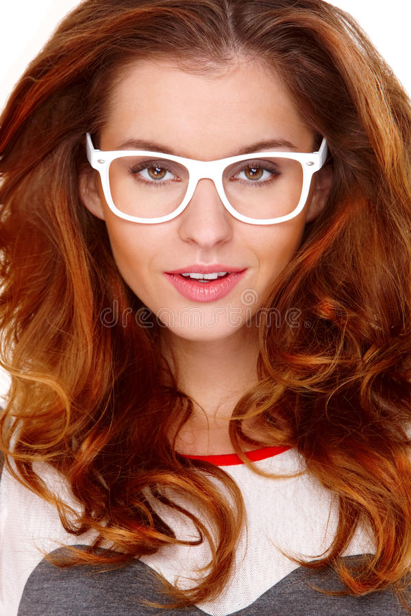 Portraif of young woman wearing glasses on white