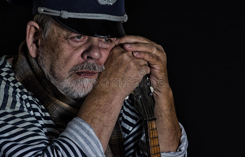 Portrair of retired military man. Thinking about hard life royalty free stock photography