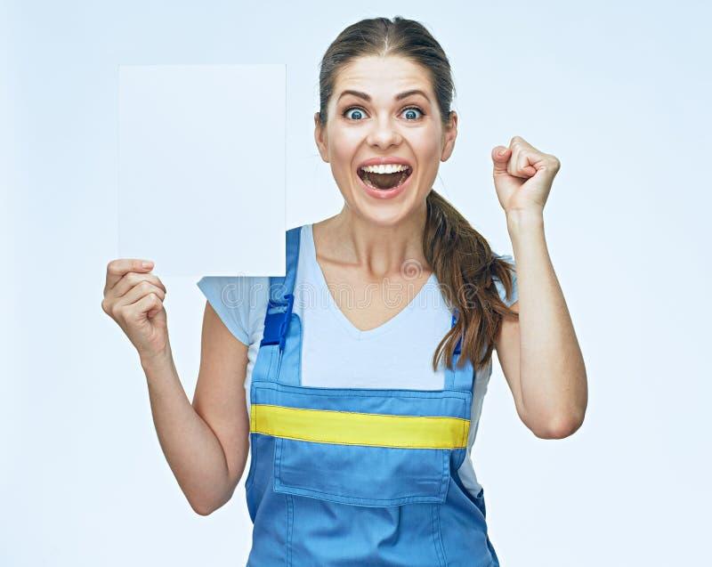 Portrait étonnant de constructeur de femme avec la bannière blanche photo stock