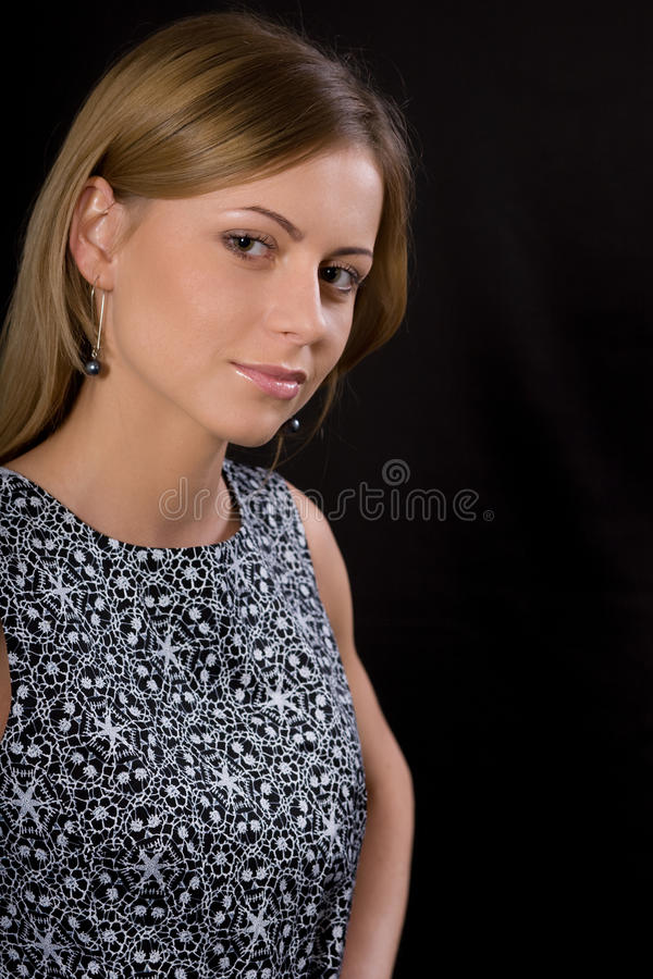 Portrait. The young beautiful girl on a black background royalty free stock photo