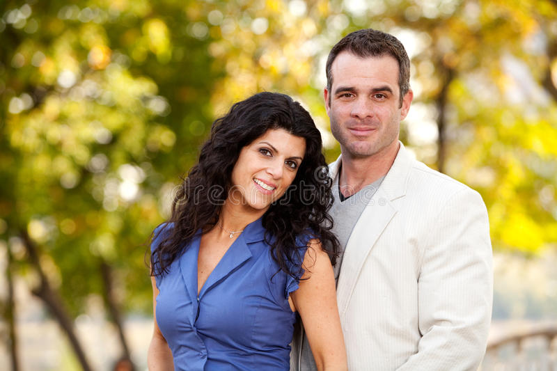 Portrait. A portrait of a happy male and female in a park stock photography