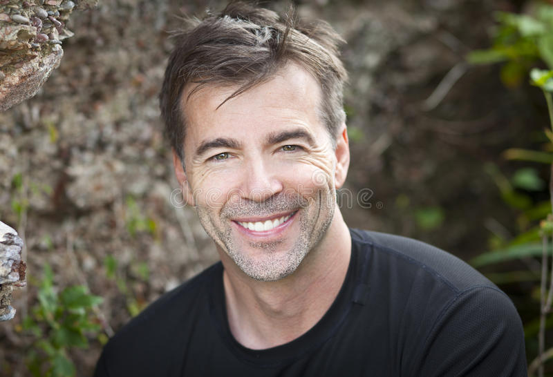 Portrait Of A Active Man Smiling At The Camera. Portrait Of A Mature Active Man Smiling At The Camera. This man loving hiking and outdoors sports royalty free stock photos