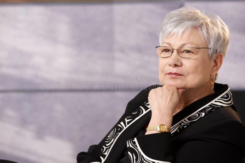 Portrait of active senior woman stock photos