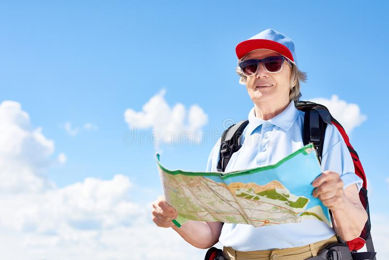 Active Senior Woman Holding Map stock images