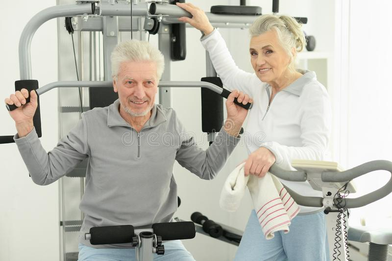 Portrait of active smiling senior couple exercising royalty free stock images