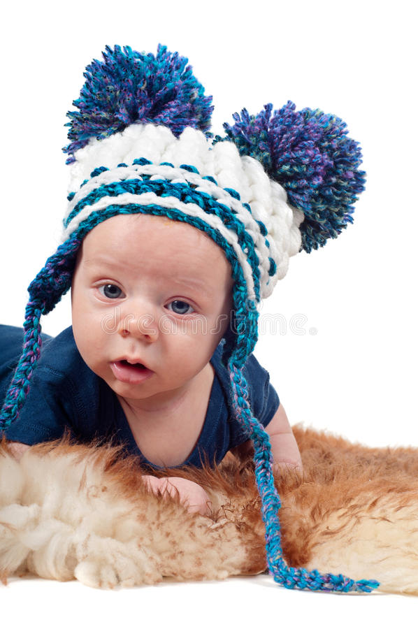 Portrait of adorable baby boy in knitted hat royalty free stock photography