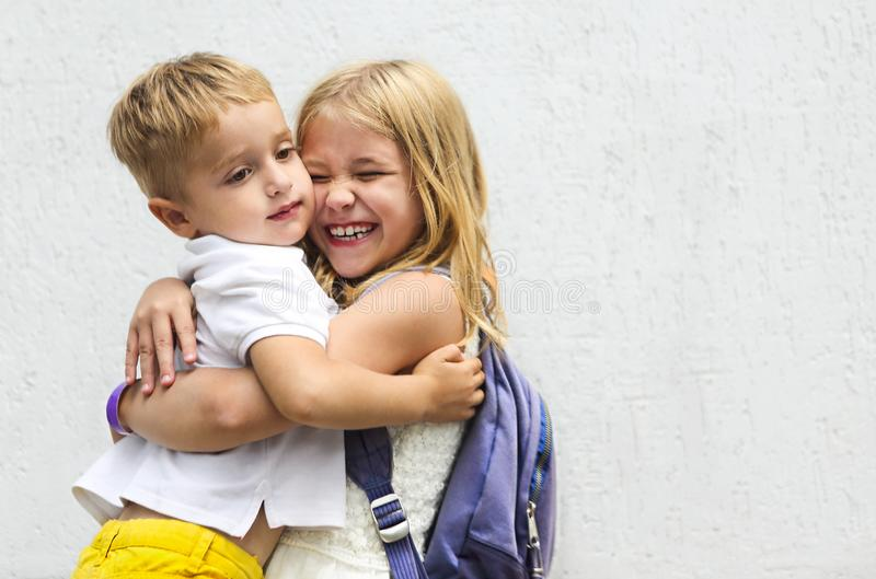 Portrait of adorable brother and sister smile and laugh together outdoors royalty free stock photos