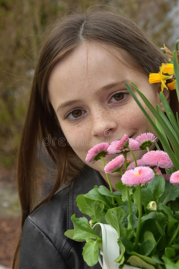 Cute teenage girl with colorful flowers royalty free stock photo