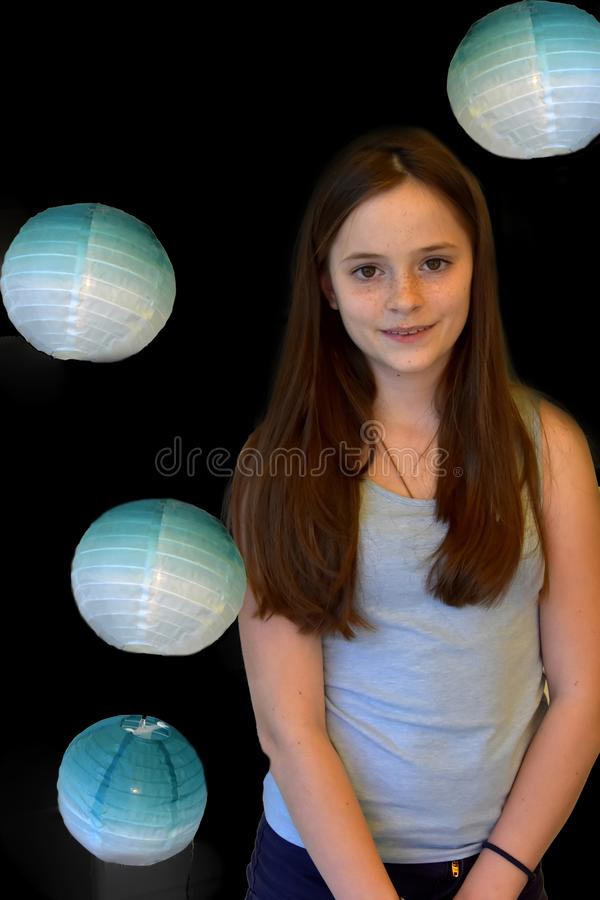Girl and blue paper lanterns royalty free stock photo