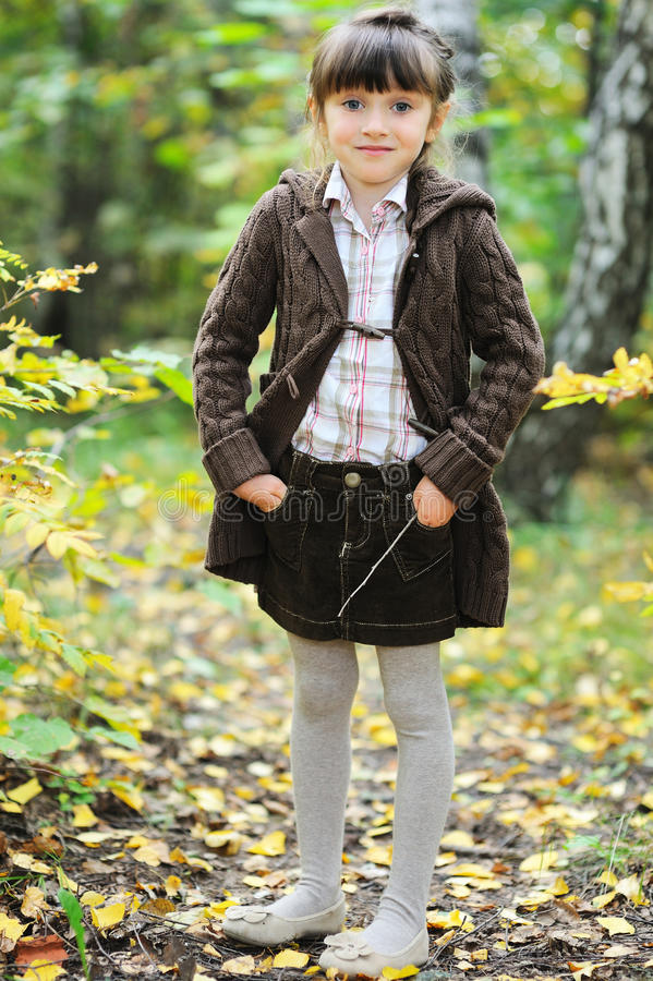Portrait of adorable child girl in autumn forest royalty free stock photo