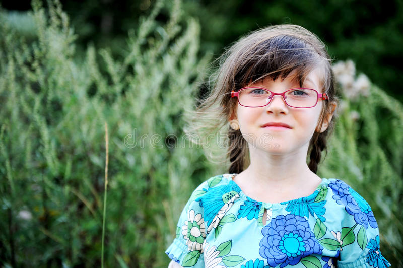 Portrait of adorable child girl in glasses royalty free stock images