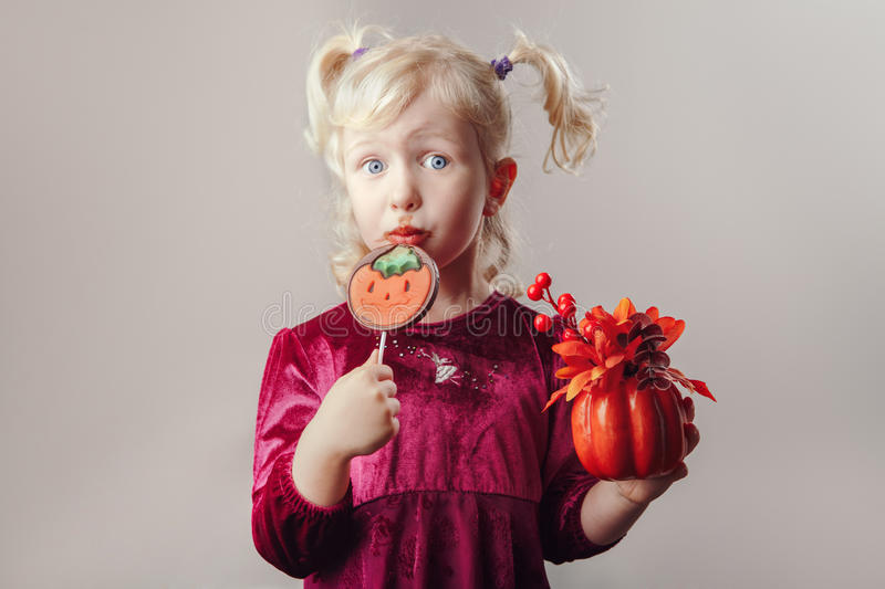 Funny white blonde Caucasian girl with pigtails dressed for Halloween stock images