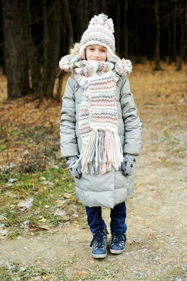 Portrait of adorable girl outdoor in winter park royalty free stock images