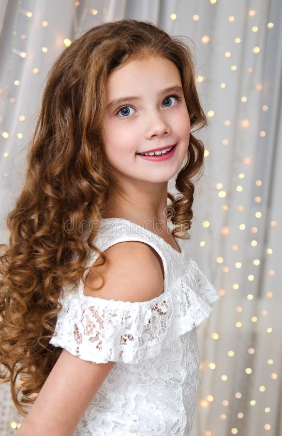 Portrait of adorable happy smiling little girl child in princess dress. In christmas time royalty free stock image