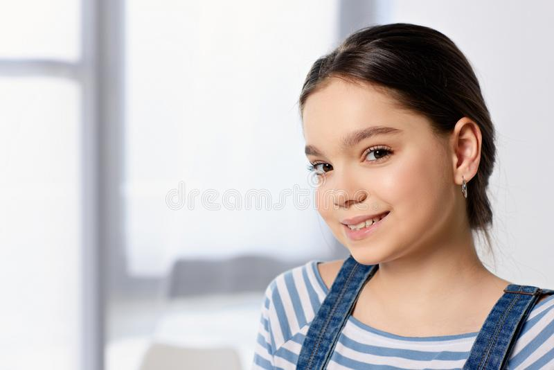 portrait of adorable preteen child looking at camera stock photo
