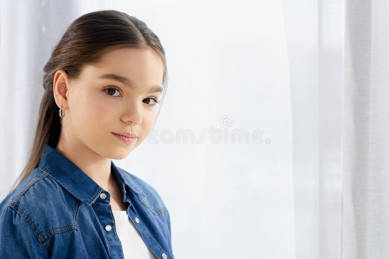 portrait of adorable preteen child looking at camera royalty free stock photo