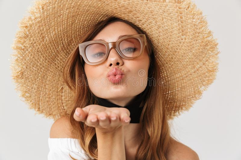 Portrait of adorable seductive woman 20s wearing big straw hat a royalty free stock photo