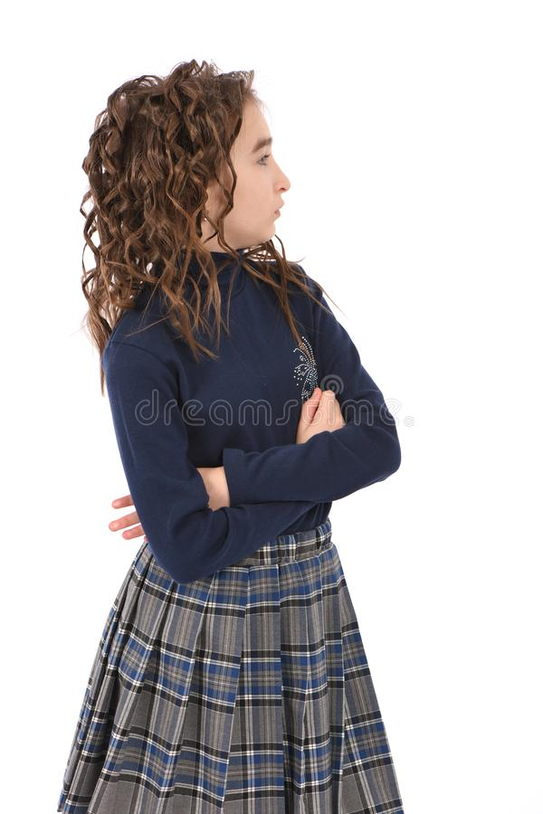 Portrait of adorable smiling girl child schoolgirl with curl hair royalty free stock image