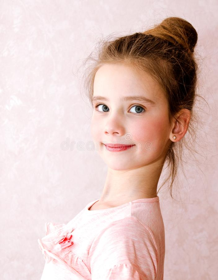 Portrait of adorable smiling little girl child. Isolated royalty free stock images