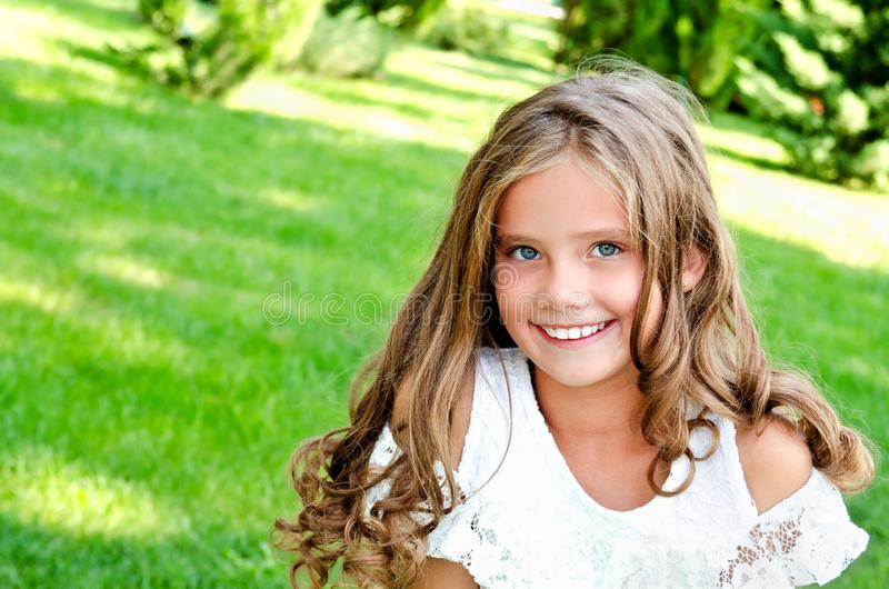 Portrait of adorable smiling little girl child outdoors stock images