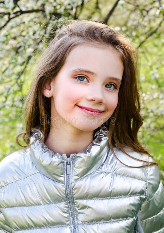Portrait of adorable smiling little girl child outdoors in spring day stock photography
