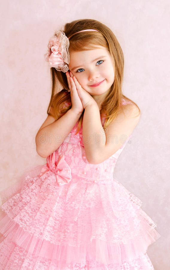 Portrait of adorable smiling little girl in princess dress stock images
