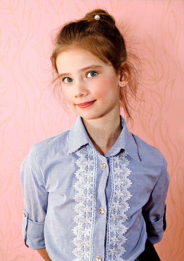 Portrait of adorable smiling little girl schoolgirl child isolated stock image