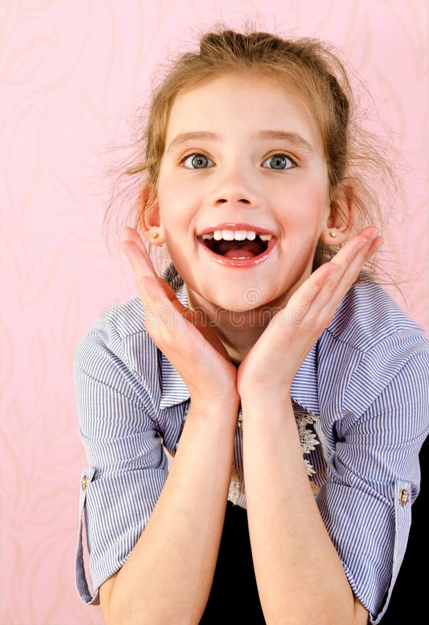 Portrait of adorable smiling little girl schoolgirl child  stock photos
