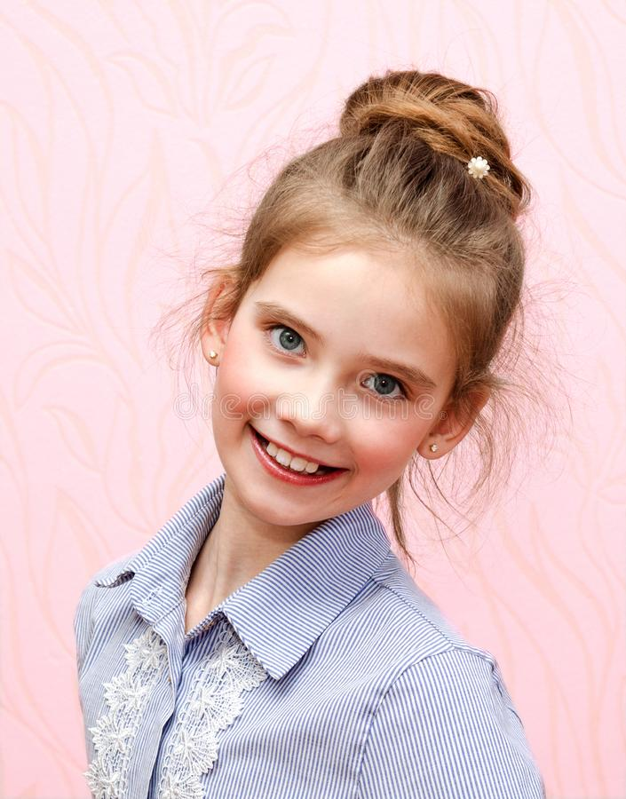 Portrait of adorable smiling little girl schoolgirl child isolated royalty free stock photos