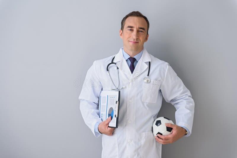 Portrait of adult doctor posing in studio stock images