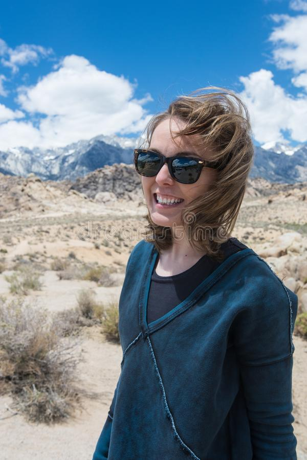 Portrait of Adult female wearing sunglasses on a windy summer day in the Alabama Hills in Lone Pine California, in the Eastern royalty free stock images