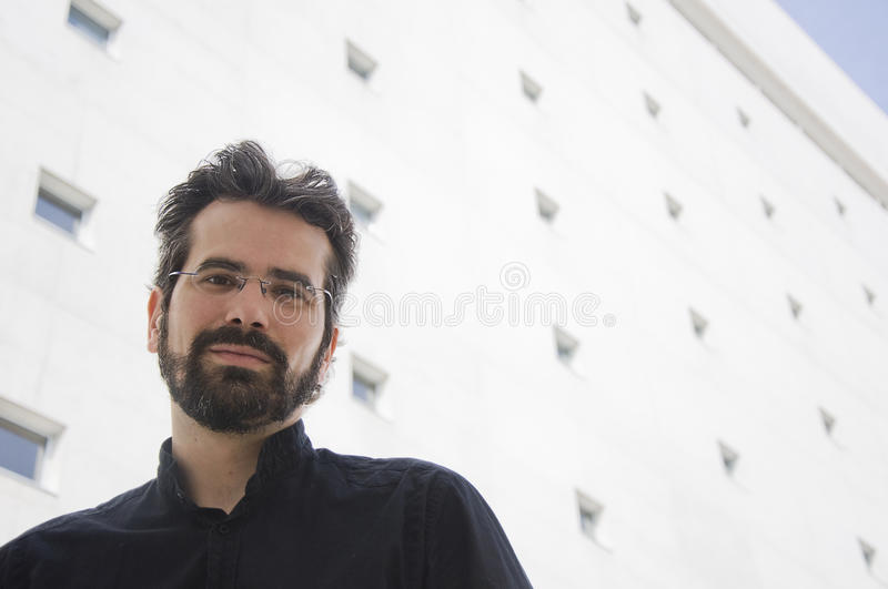 Portrait of adult man with beard and glasses stock photo