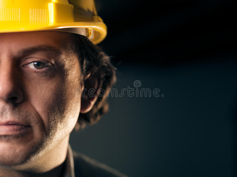 Portrait of adult manual worker with helmet stock images