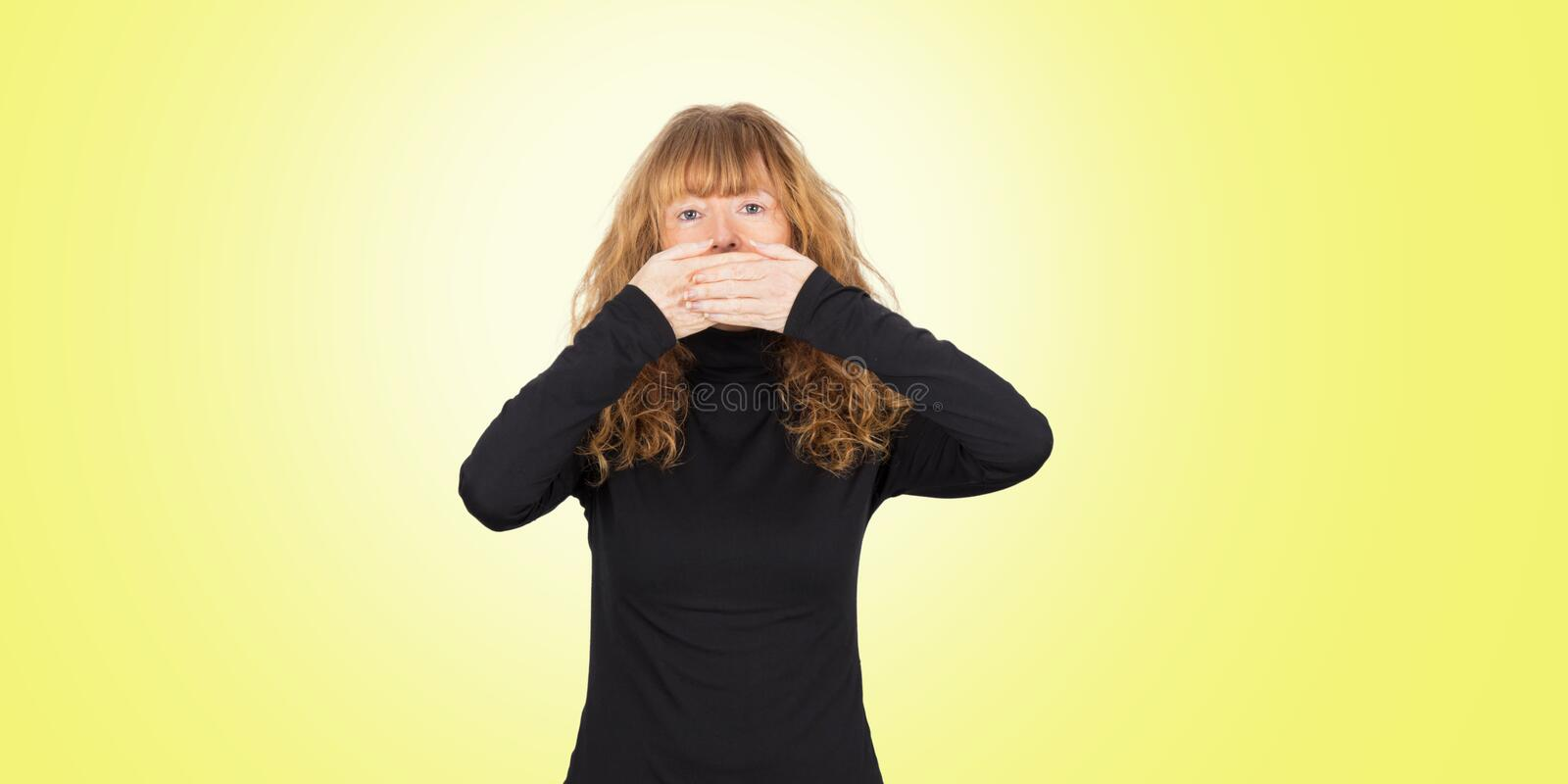 Woman silencing herself royalty free stock images