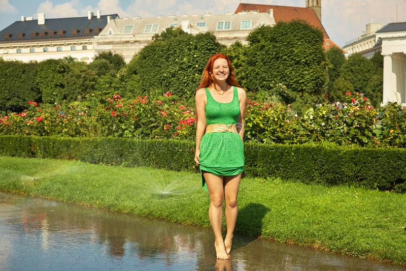 Portrait af a beautiful redhead emotional woman outdoors. stylish romantic young girl on a walk in park royalty free stock images
