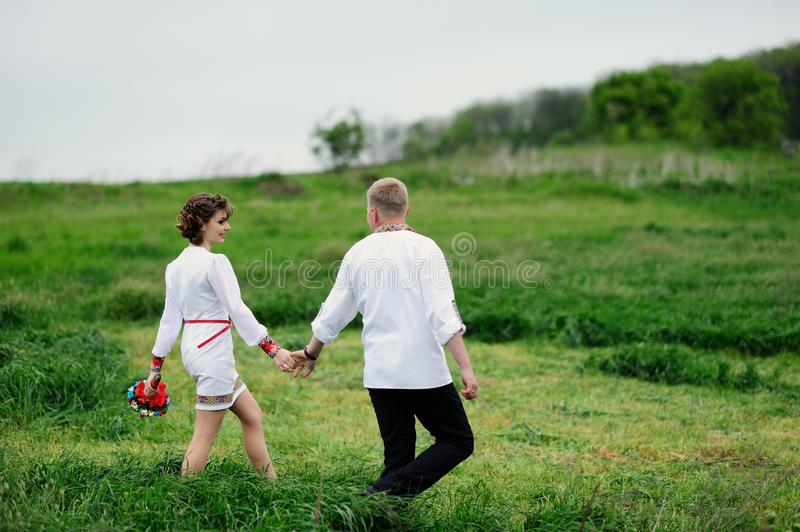Affectionate couple On a meadow . Romantic  walk. Affectionate couple On a meadow . Romantic. With royalty free stock photos