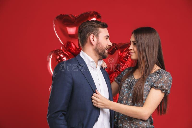 Portrait of affectionate couple celebrating valentine`s day stock photos