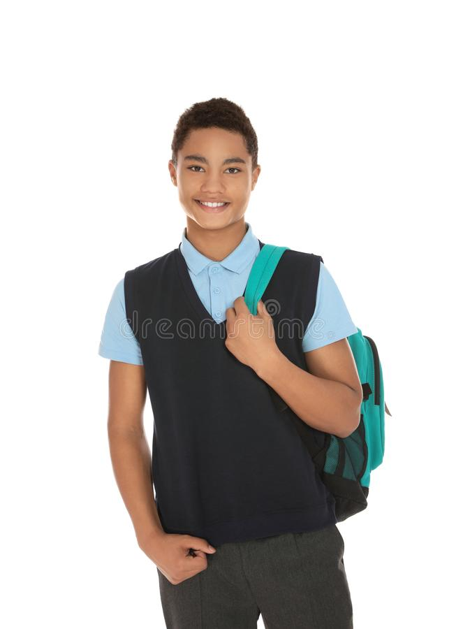 Portrait of African-American boy in school uniform with backpack on white royalty free stock photography