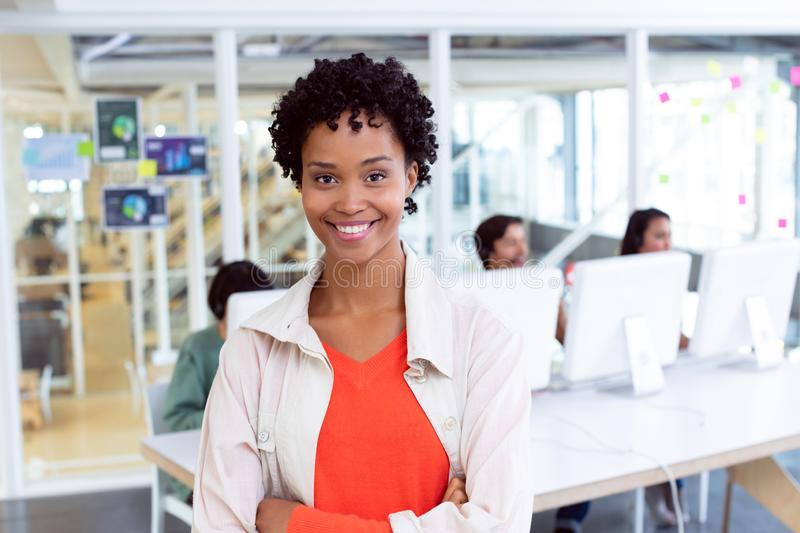 Businesswoman standing with arms crossed in the office. Portrait of African-american  Businesswoman standing with arms crossed in the office royalty free stock images