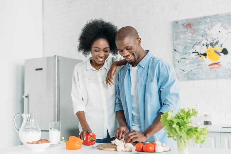 Portrait of african american cooking breakfast together in kitchen. At home stock photo