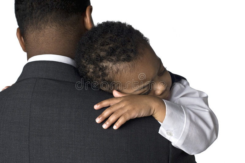 Portrait of an African American father holding his royalty free stock images