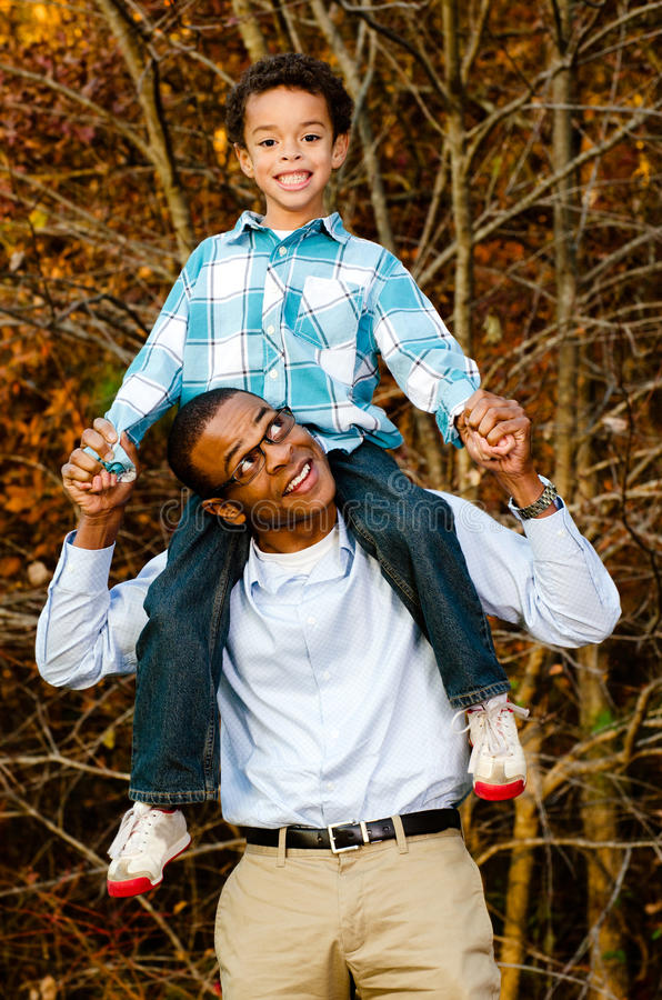 Portrait of African-American father and son stock photography