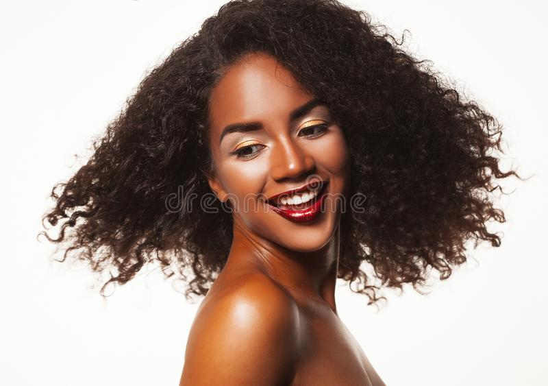 Beauty portrait of african american woman with afro hairstyle and glamour makeup. stock images