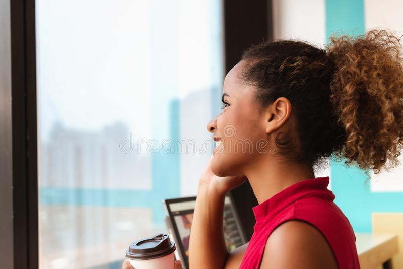 Portrait of African American Woman is Talking on Mobile Phone in Cafe Shop., Close up of Young Office Woman is Calling to Someone stock photo